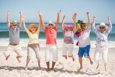 Portrait of senior friends at the beach